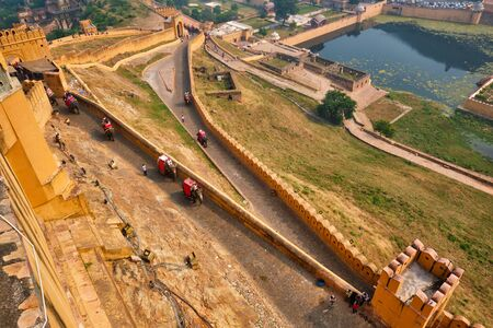Tourists riding elephants on ascend to Amer fort