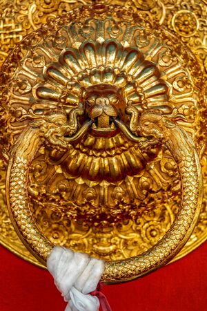 Lion shaped door handle in Buddhist temple