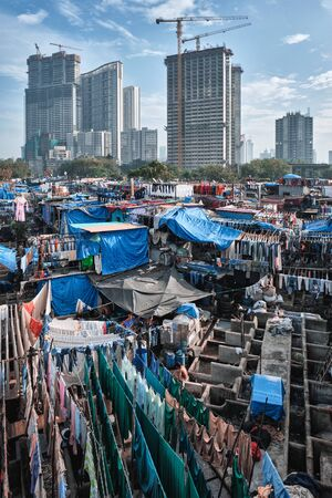 Dhobi Ghat is an open air laundromat lavoir in Mumbai, India with laundry drying on ropes Stock Photo