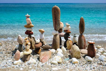 Concept of balance and harmony - pebble stone stacks on the beach Stok Fotoğraf