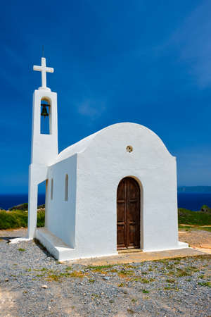 Greek traditional white washed orthodox curch Фото со стока