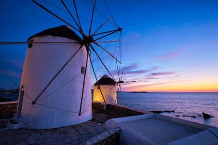 Traditional greek windmills on Mykonos island at sunrise, Cyclades, Greece 版權商用圖片