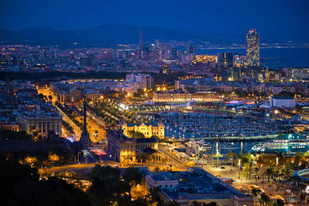 Aerial view of Barcelona city and port with yachts