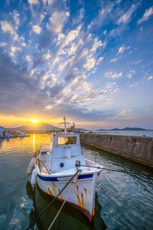 Fishing boat in port of Naousa on sunset. Paros lsland, Greece