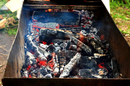 smolder: Burning charcoal in the background in barbecue Stock Photo