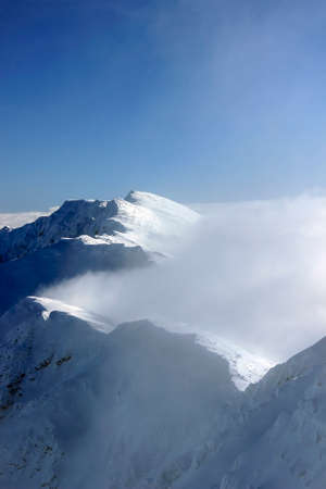 snowy mountains: Snowy mountains covered with clouds Tatras Slovakia