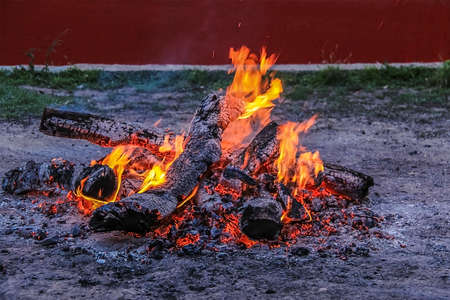 smoldering: It lit a fire smoldering charcoal evening Stock Photo