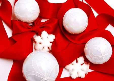 White christmas balls with snowflakes on red ribbon isolated on white Stock Photo - 16268450
