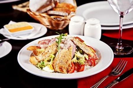 Caesar salad served on plate in restaurant