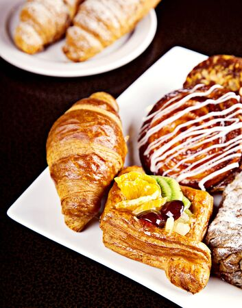 Mix of different pastry on white plate