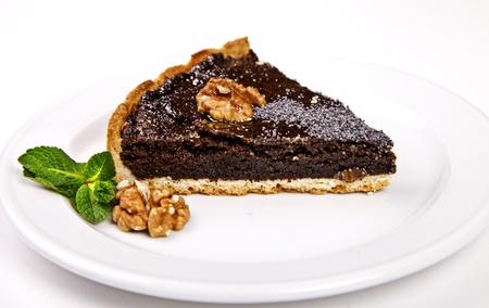 Poppy pie with walnut and mint on white background Stock Photo