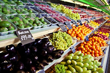 Vegetables and fruits on shelfes in supermarket