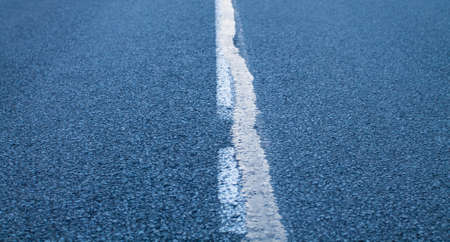 marking: Closeup shot of asphalt road with road marking. Stock Photo
