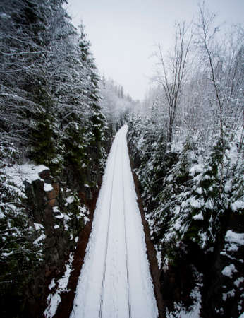 narrowgauge: High-angle view to old narrow-gauge railroad track covered with snow.