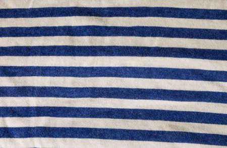 striped vest: Striped vest closeup. Blue and white lines on textile.