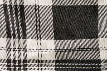 checked fabric: Black and white checked fabric with folds.