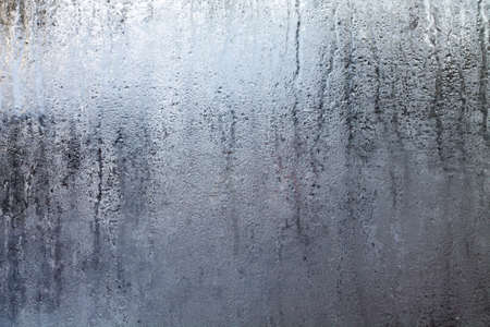 Closeup shot of a steamy window with water drops made in dull day. Stock Photo