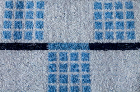 terrycloth: Closeup shot of terry towel with geometric pattern of blue squares and thick horizontal lines.