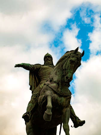 yuri: Low-angle shot of the Yuri Dolgorukiy monument in Moscow, Russia with clouds on the background.