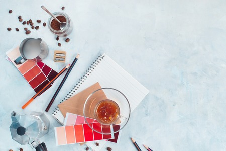 Designer workplace with coffee pot, color swatches, notes and coffee cups. Creative top view hot drink concept with copy space. Archivio Fotografico