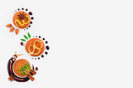 Header with a colorful pattern made of cookies, chocolate swooshes and rings, cinnamon, lemon zest and green leaves. Stock Photo