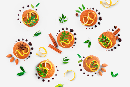 Food styling tips pattern made of cookies, chocolate swooshes and rings, cinnamon, lemon zest and green leaves. Cookie decoration concept