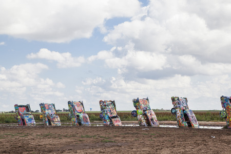 Cadillac Ranch. Yellow. Texas. USA. created in 1974 by Chip Lord, Hudson Marquez and Doug Michels Editorial