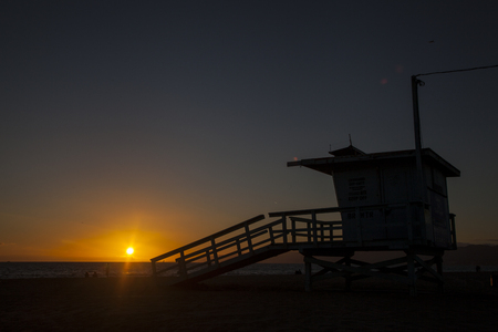 Lifeguard hut on Venice beach at sunset against light. California. USA