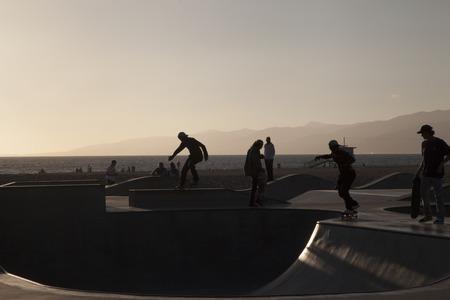 skateboarder backlit at Venice Beach skate park. California. USA