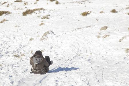 Woman having fun in the snow Standard-Bild