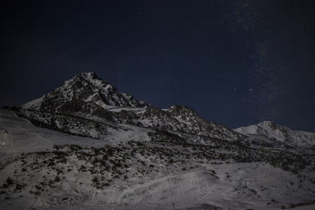 Night landscape of snowy mountain 写真素材