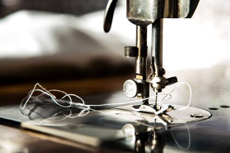 detail sewing machine with thread