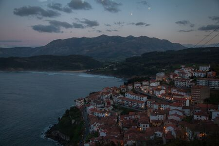 landscape of the town of Lastres at sunset