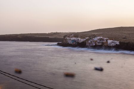 views of the town of Tufia in Gran Canaria at dusk in long exposure