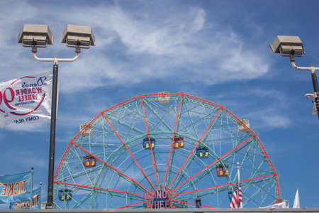 ferris wheel of coney island in sunny day