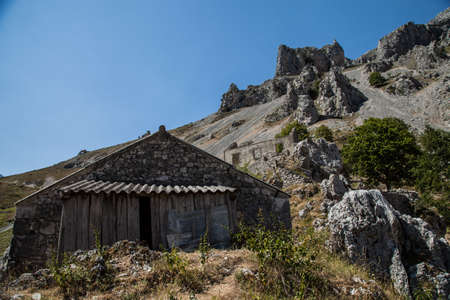 abandoned stone house on the route of the cares