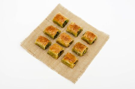 pattern with baklava on fabric. Sweets abstract background. Baklava on the white background. Stok Fotoğraf