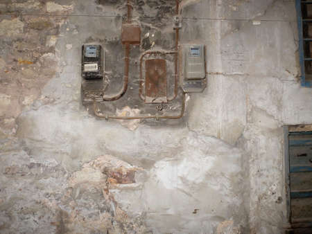 breaker: view of electric and breaker boxes on the side of a house