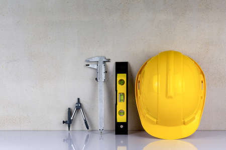 Safety helmet and equipment of carpenter with wooden background.Labor market of joiner and craftsman concept.Free space.
