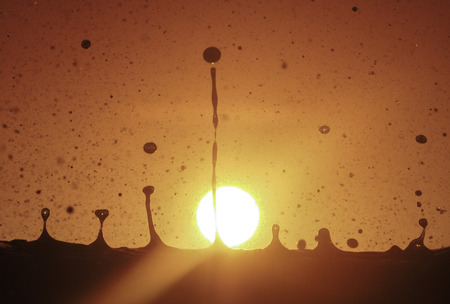 Reverse water droplets, suspended by sunset Banco de Imagens