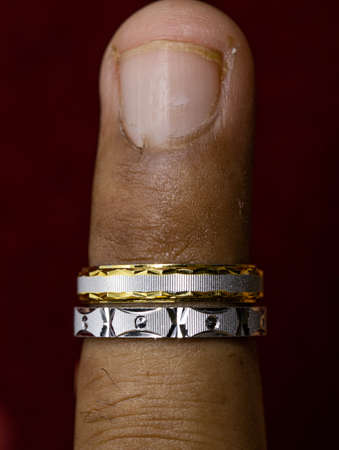 Wearing a round silver one ring and gold one