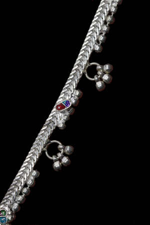 three Curly silver anklet with painting for catalogue design book Stock Photo