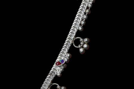 Beautiful catalogue design book of silver anklets on black background