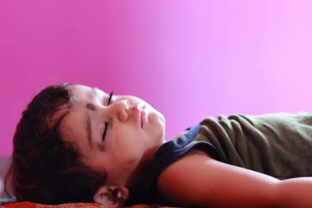 A beautiful baby sleeping inside the room with blurry pink Room wall, free child Images