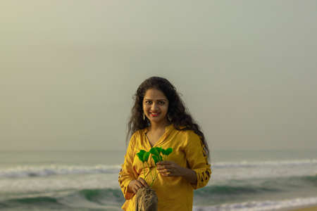 gold portrait of hindu young woman at Chennai beach in India