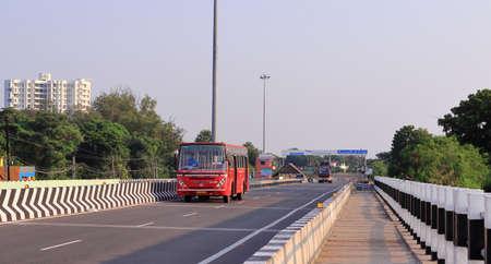 Chennai, Tamil nadu , India . Oct 07,2020.Tamil Nadu government's red local city bus runs on road, Chennai, Tamil Nadu, India. 新闻类图片