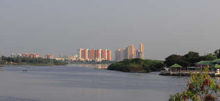 Chennai, Tamil nadu , India . Oct 07,2020.Huge modern new apartment buildings near OMR Road, Chennai city and beautiful scenic river in front and this panorama photo was taken from ecr Road