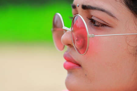 profile view woman face with closeup gorgeous lips , wearing on eyes stylish summer fashion sun glass