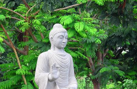 Statue of white rock made of Gautama Buddha.