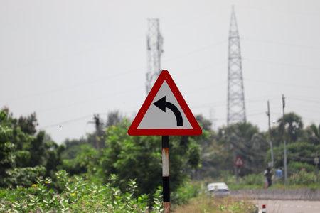 Left curve traffic sign background. 免版税图像